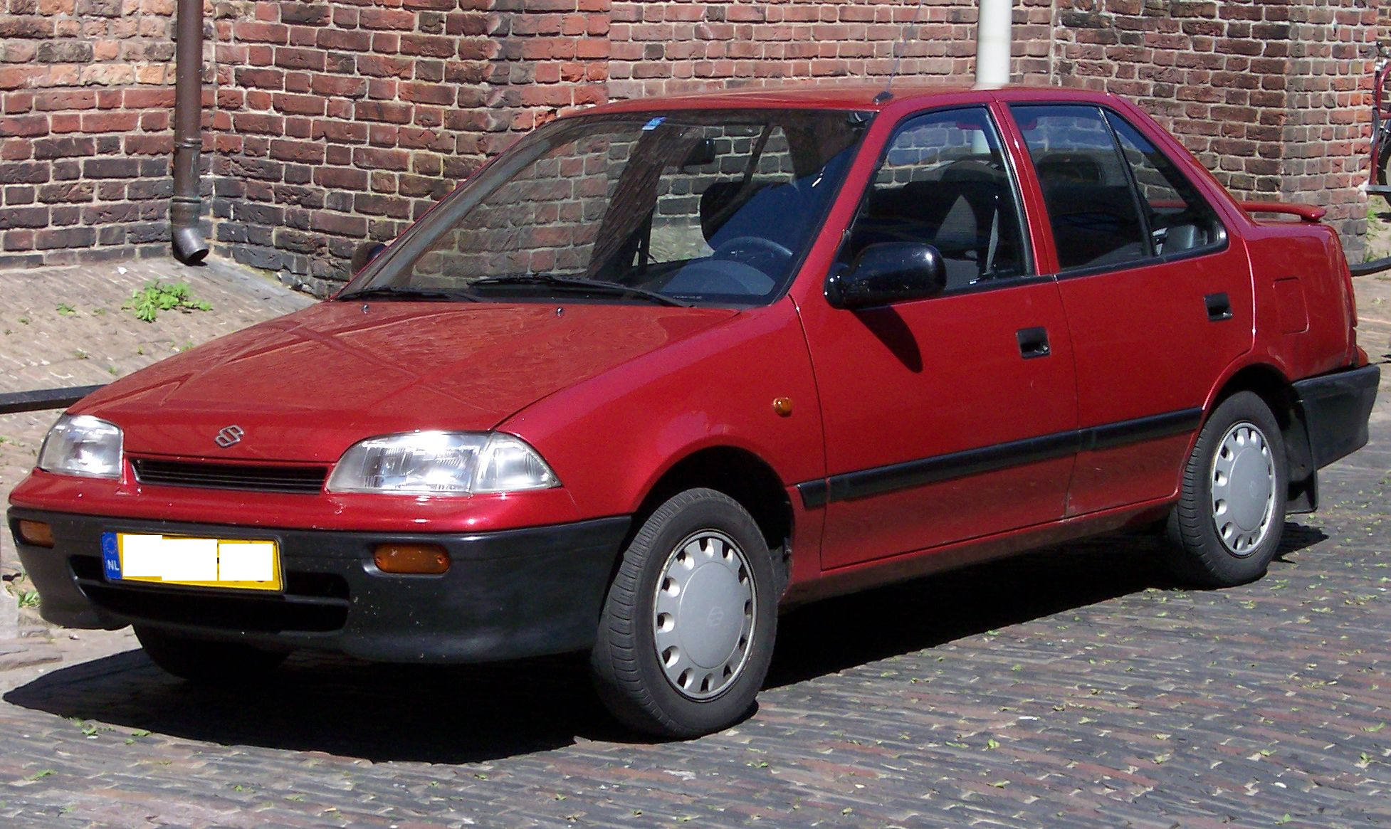 Pictures of suzuki baleno hatchback (eg) 1998